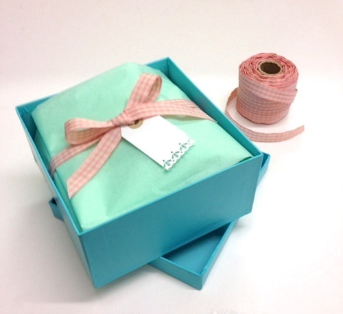 Gift Wrapping Project Lining Gift Boxes With Tissue And Ribbon
