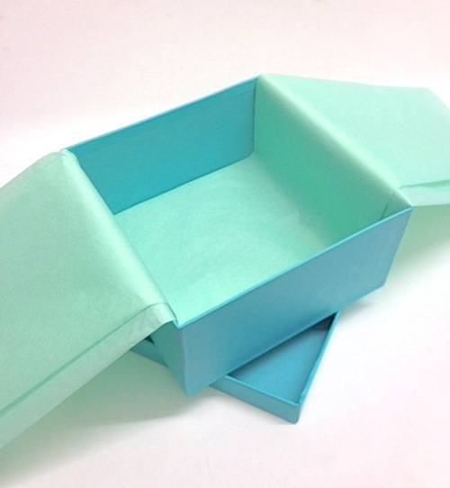 Gift wrapping project lining gift boxes with tissue and ribbon turquoise gift box negle Choice Image