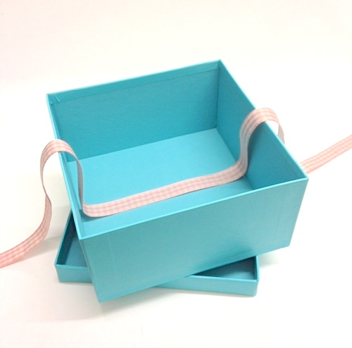 Gift wrapping project lining gift boxes with tissue and ribbon gift boxes turquoise negle Choice Image