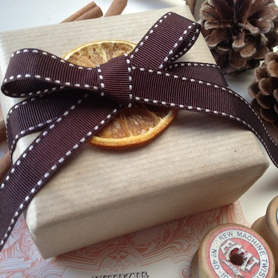 Brown stitched ribbon roll