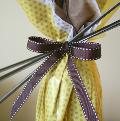 brown stitched ribbon bottle