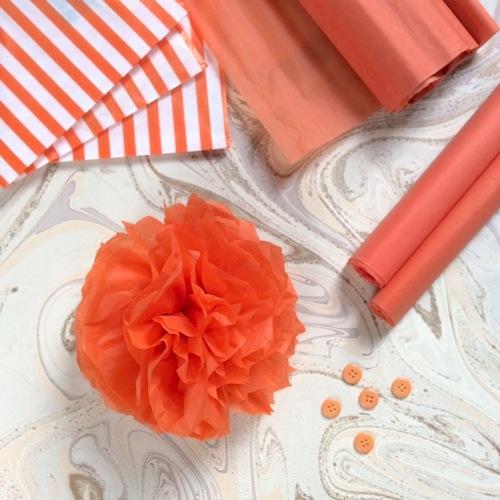 orange tissue pom pom