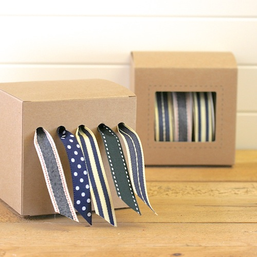 Ribbon storage dispenser