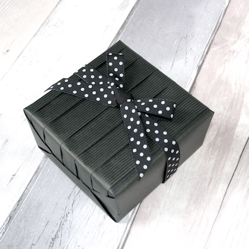 black pleated gift