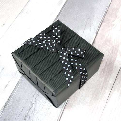 black pleated gift